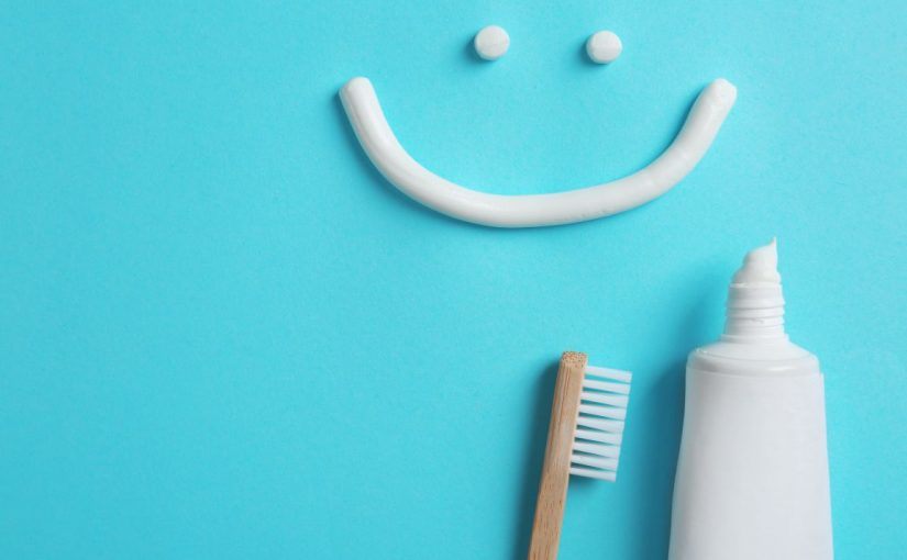 a toothpaste smiley face with toothpaste and toothbrush
